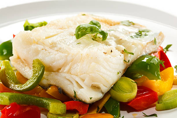 Boiled cod and vegetables stock photo