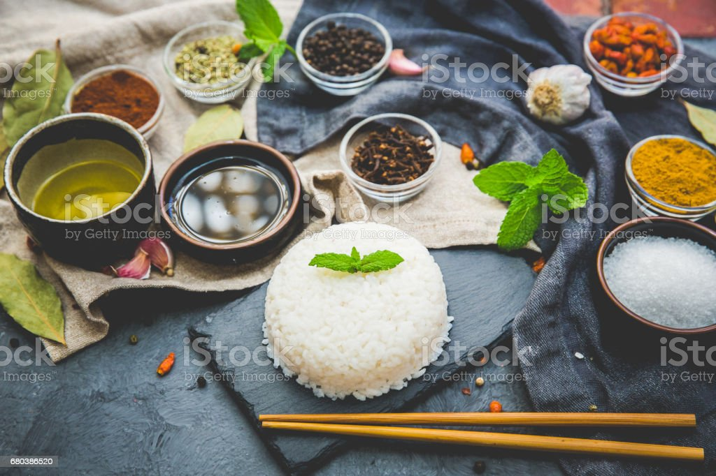 Boiled Dish Rice with vegetables and spices over dark rustic background. Vegetarian Asian food concept. royalty-free stock photo