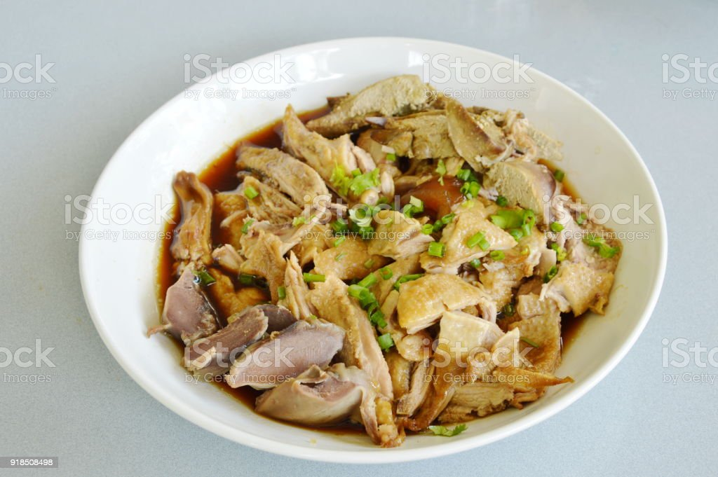 boiled duck in brown soup slice and topping chop spring onion stock photo