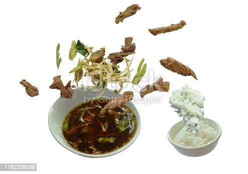 boiled duck in Chinese herb brown soup eat couple plain rice floating on bowl in white background