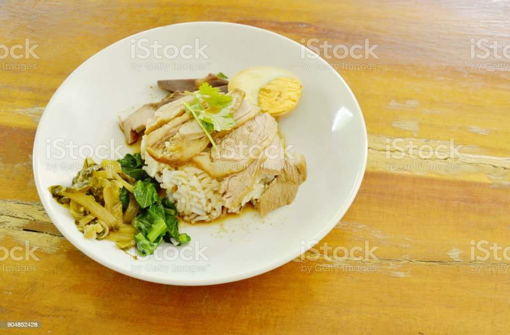 boiled duck meat dressing brown sauce with egg on rice stock photo