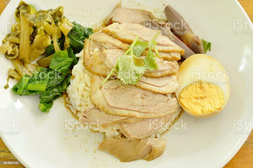 boiled duck meat dressing brown sauce with pickled cabbage on rice stock photo