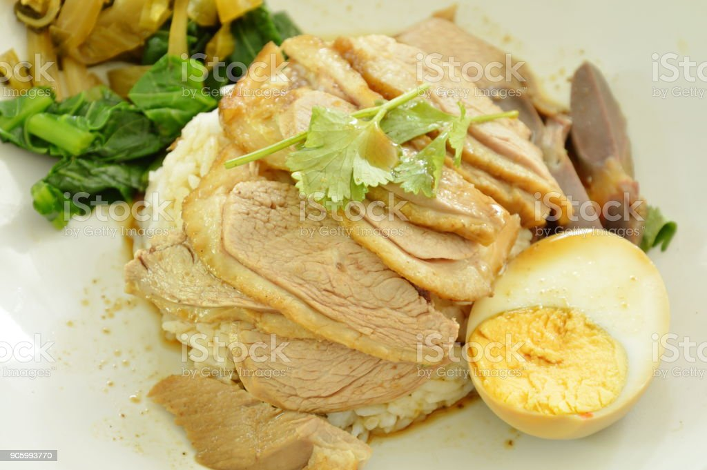 boiled duck meat slice dressing brown sauce with pickled cabbage on rice stock photo