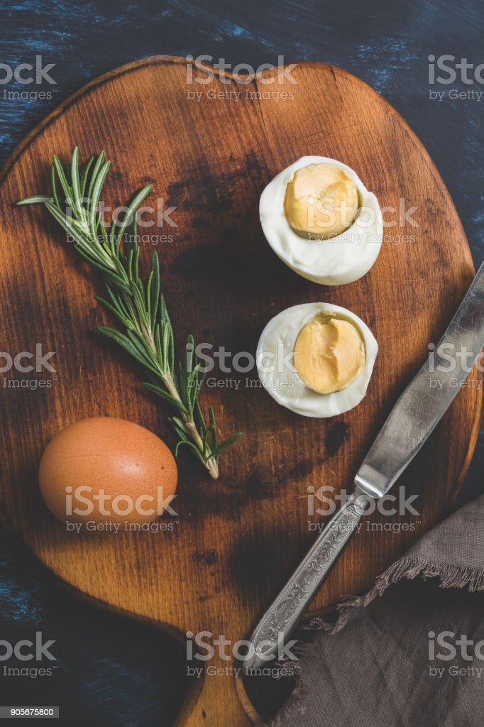 Boiled egg halves on a cutting board. stock photo