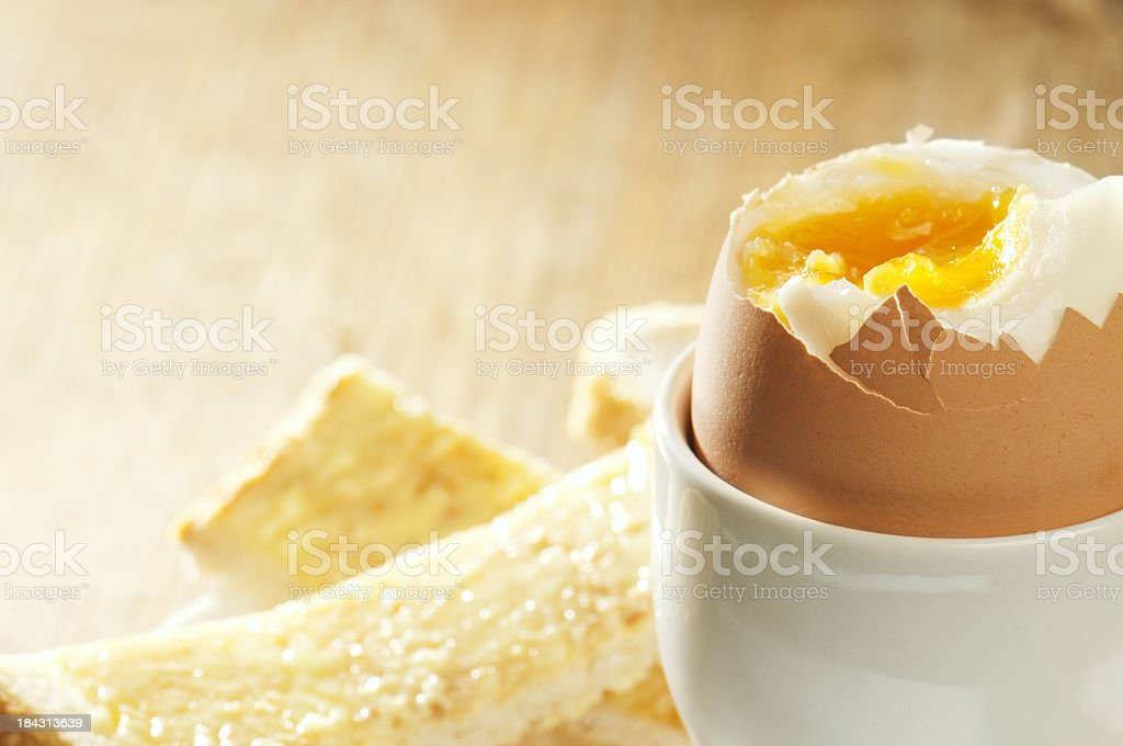 Boiled egg in eggcup with buttered toast soldiers royalty-free stock photo
