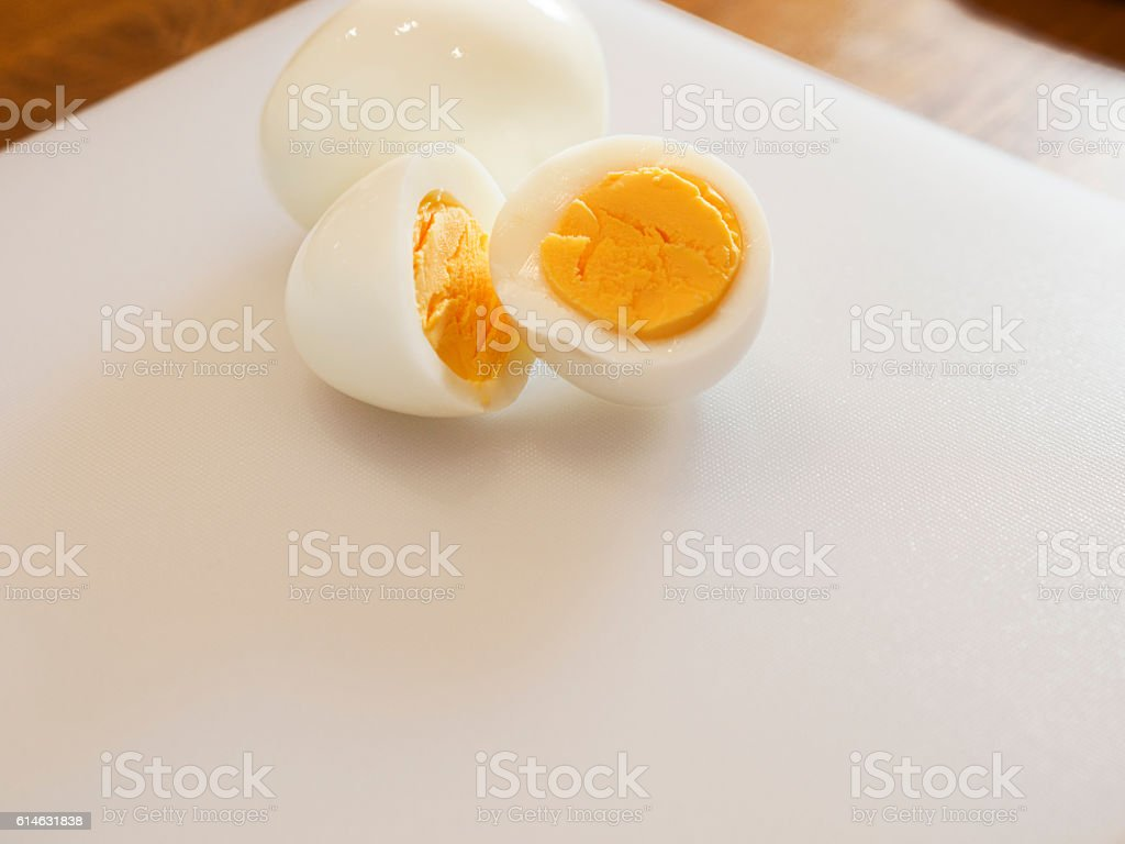 Boiled egg on the chopping board ストックフォト