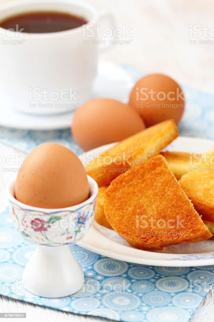 Boiled eggs and toasts for breakfast stock photo