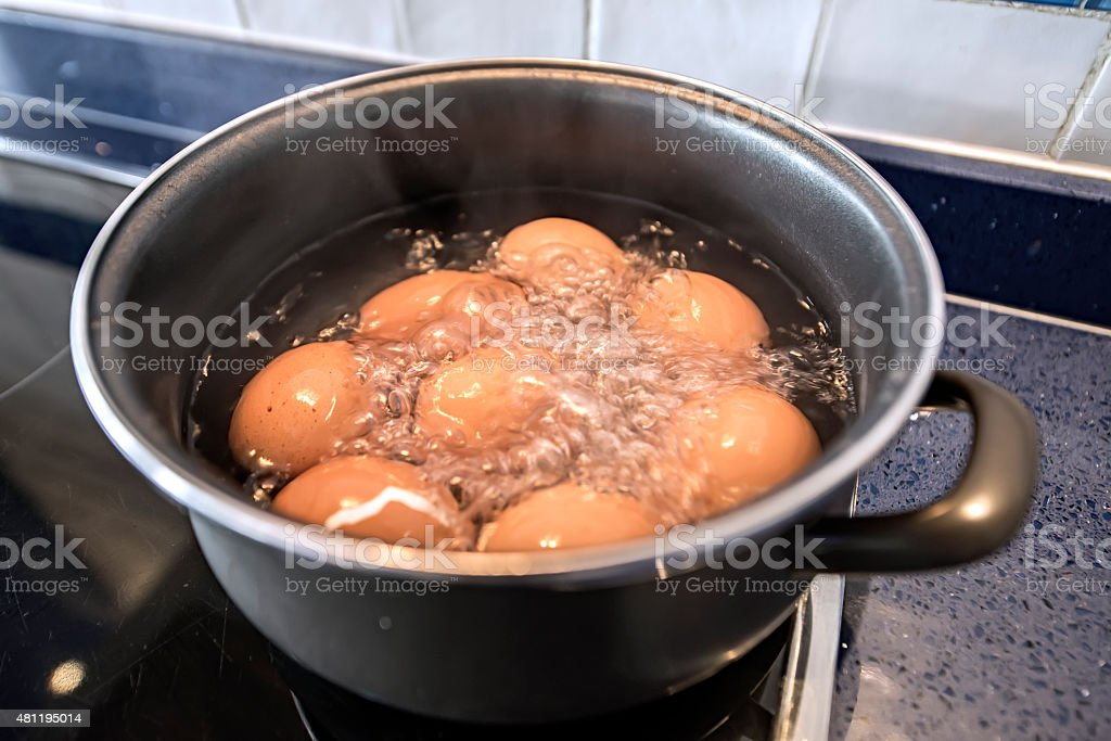 Boiled eggs cooking stock photo