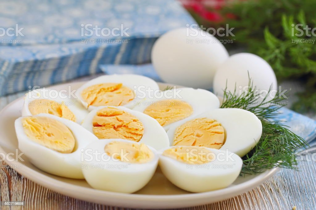 Boiled eggs on the plate stock photo