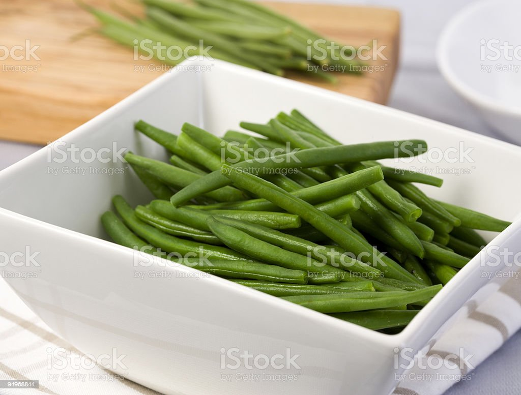 boiled green beans in white  bowl stock photo