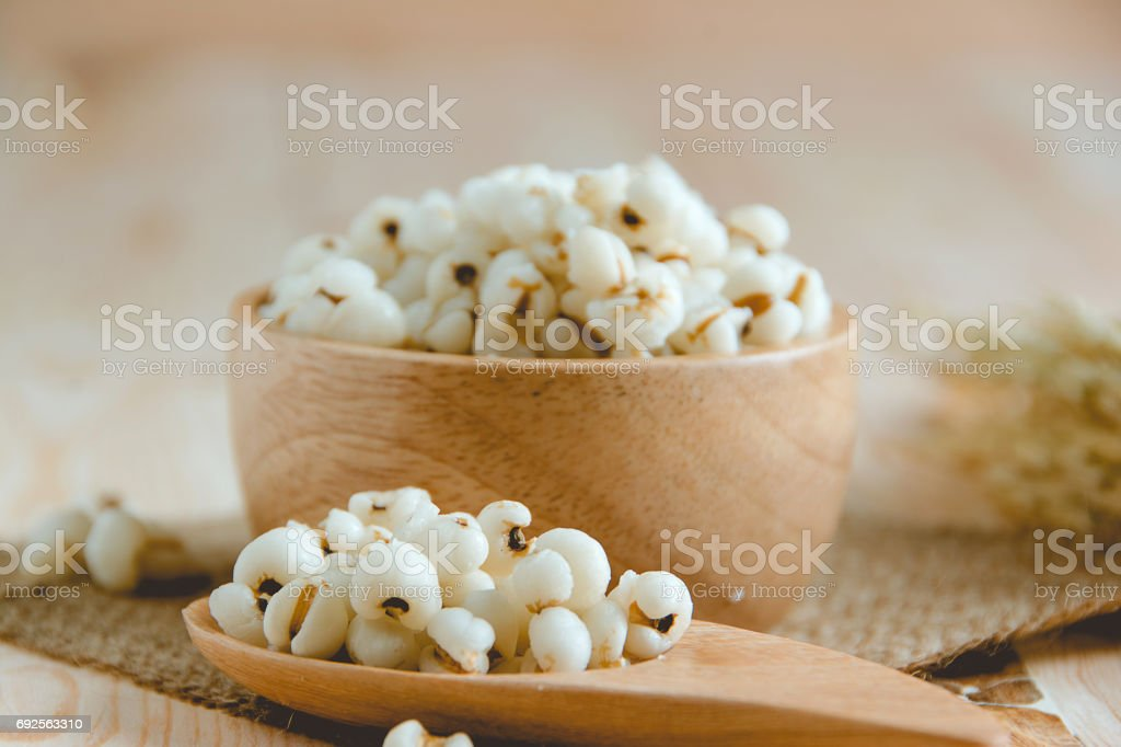 boiled Job's Tears in wood bowl stock photo