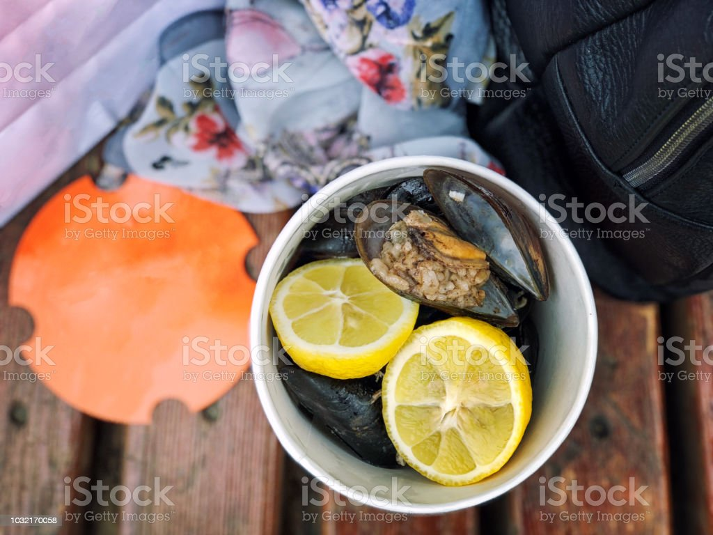 Boiled mussels with rice flat lay. Food tavel concept