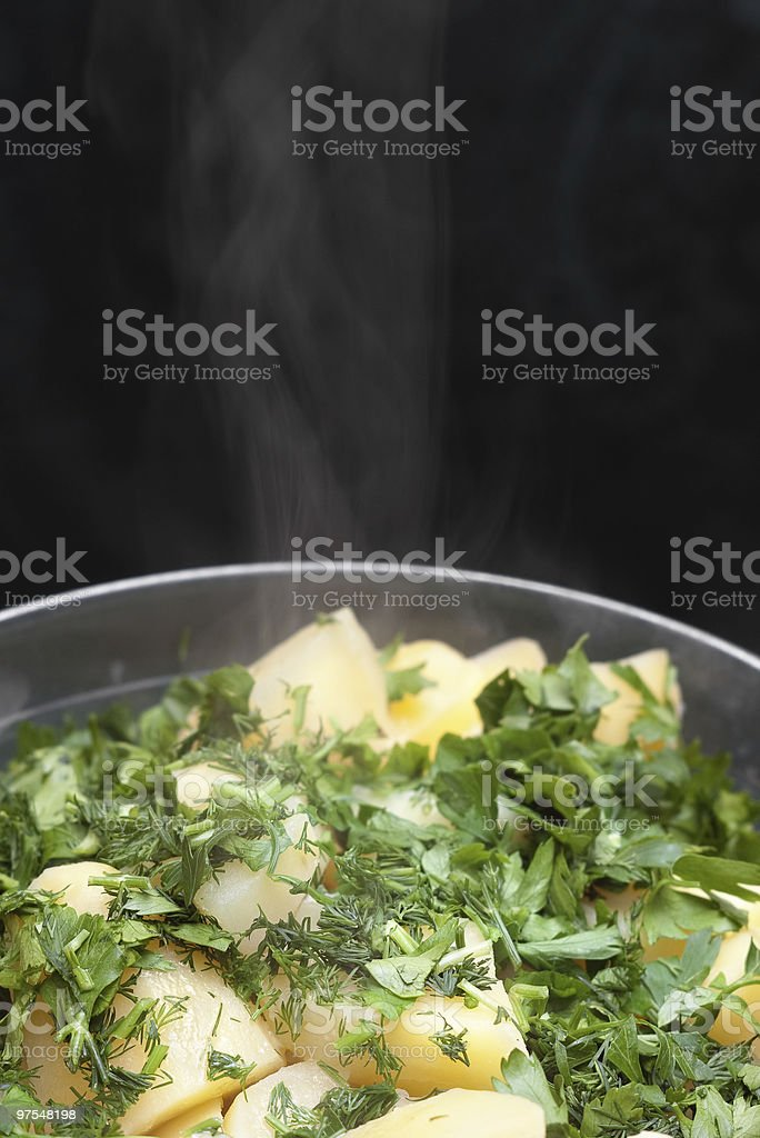 boiled potatoes with steam smoke royalty-free stock photo
