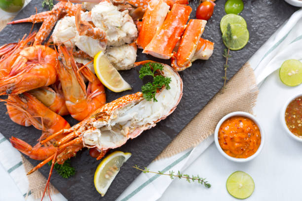 boiled prawn and lobster on stone plate stock photo