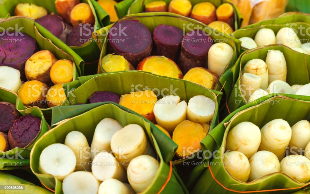 Boiled purple, yellow and white yams wrapped. stock photo