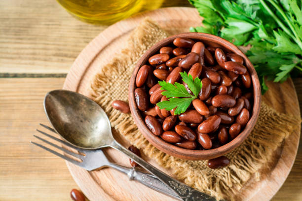 Boiled red beans in ceramic bowl. stock photo