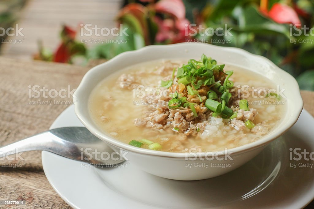 Boiled rice pork or mush - Thai style breakfast stock photo