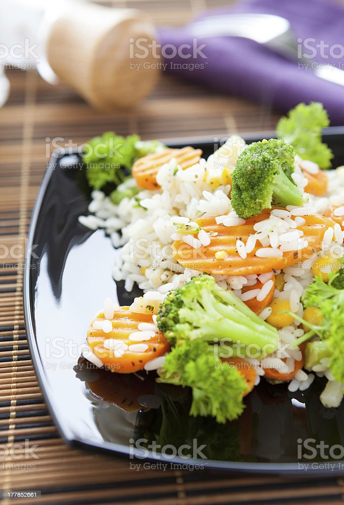 Boiled rice with carrots and broccoli royalty-free stock photo