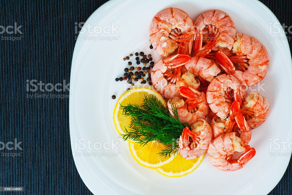 Boiled royal Argentine shrimp with lemon, dill and pepper stock photo