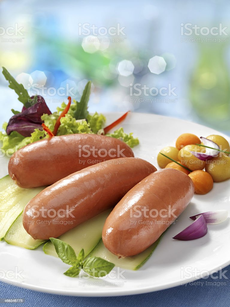 Boiled sausage with greens royalty-free stock photo