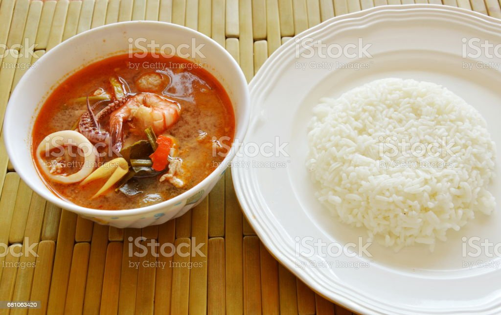 boiled seafood and pork tom yum Thai spicy soup with rice royalty-free stock photo