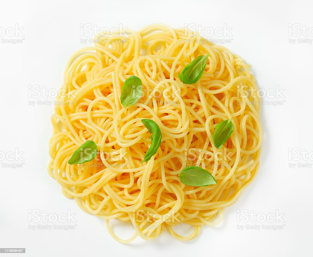 boiled spaghetti with basil royalty-free stock photo