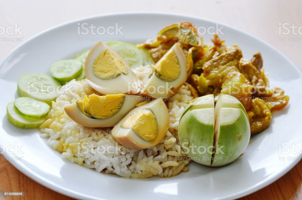 boiled sweet brown egg and spicy stir fried wild boar red curry royalty-free stock photo