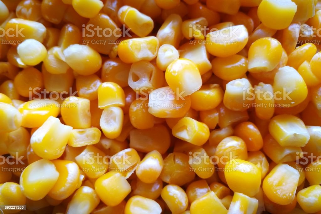 Boiled sweet corn seeds texture in yellow and white colors - top view. stock photo