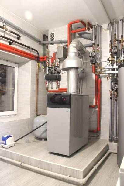 boiler and pipes of the heating system of the house. - furnace stock photos and pictures
