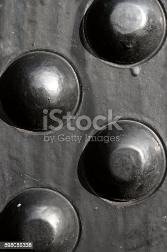 Steel rivets used to build the boiler of an old steam locomotive.