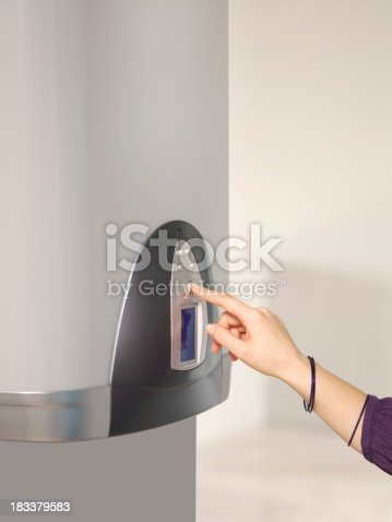 istock Boiler uses the woman's hand 183379583
