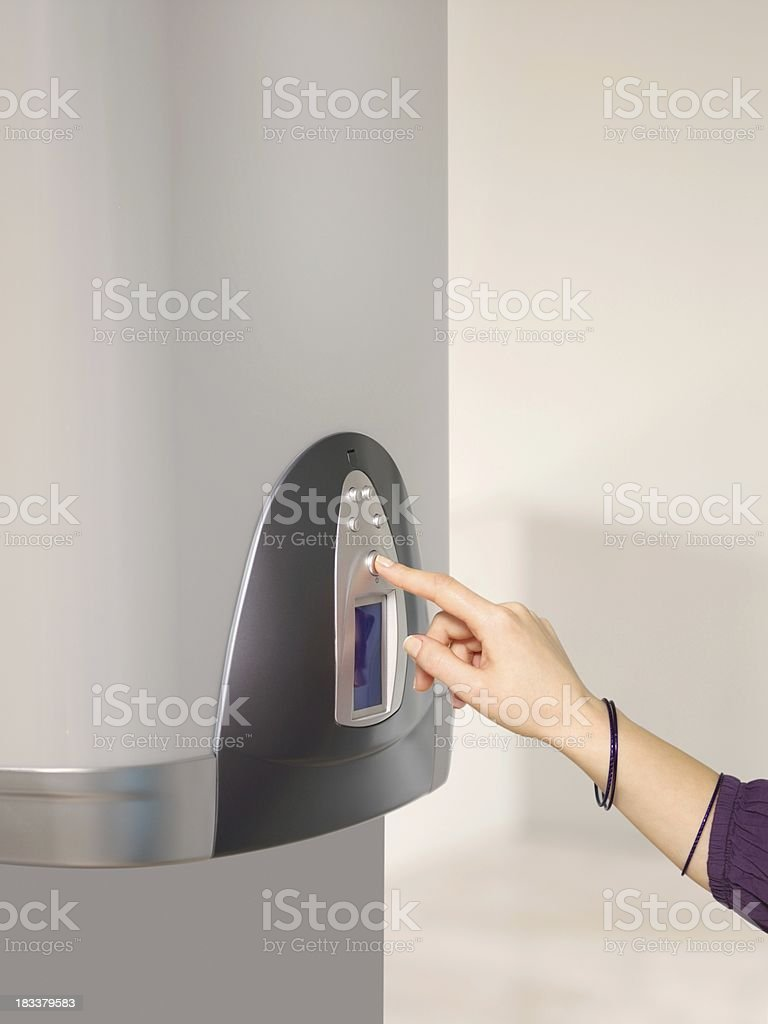 Boiler uses the woman's hand stock photo