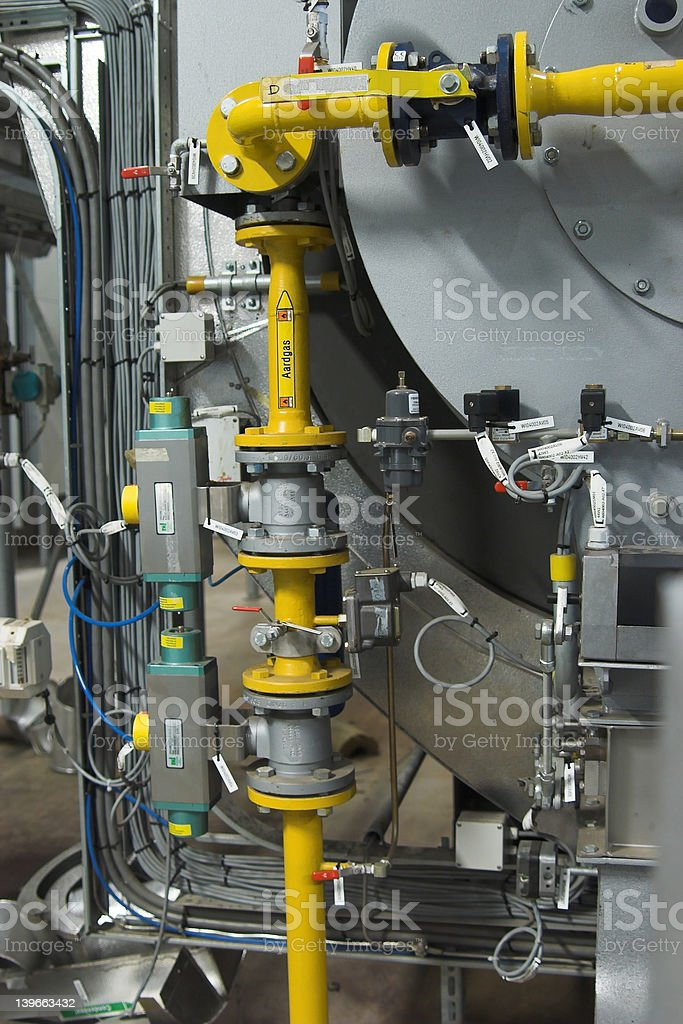 Boiler with pipes, valves and cabling royalty-free stock photo