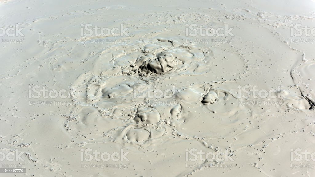 Boiling crater of mud volcano stock photo