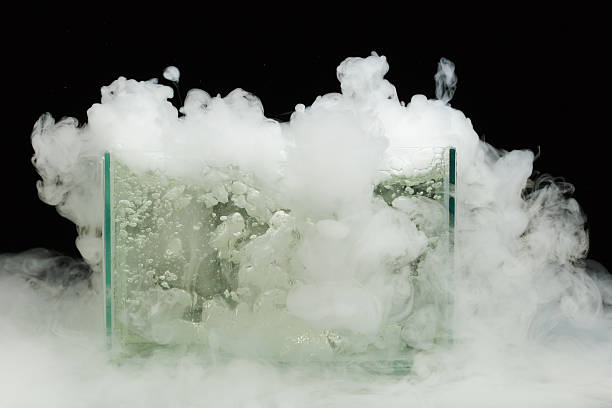 boiling dry ice with vapor boiling dry ice with huge amount of vapor chemical reaction stock pictures, royalty-free photos & images