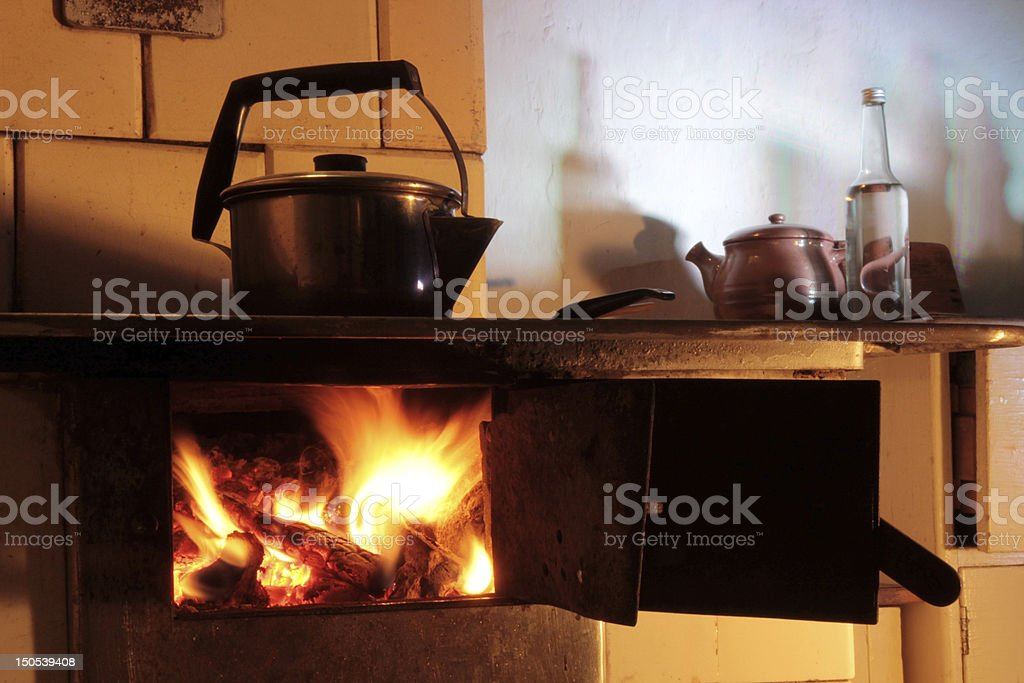 boiling kettle at the cottage royalty-free stock photo
