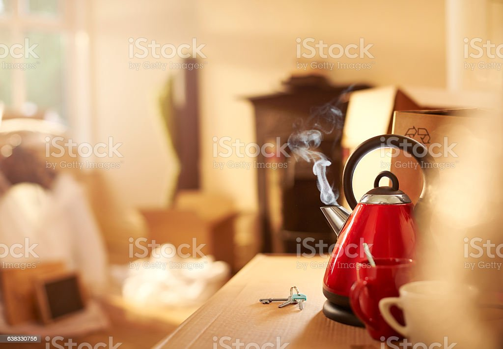 boiling kettle in new home stock photo