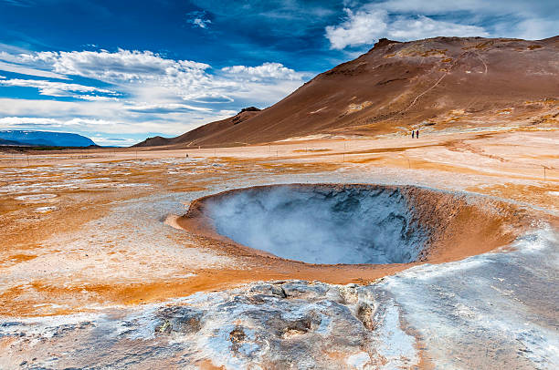 boiling mudpot in hverarond geothermal field, iceland - desolated stock pictures, royalty-free photos & images