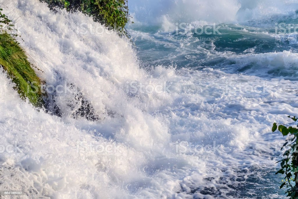 Boiling powerful water streams fall with splashes creating waves, background. royalty-free stock photo