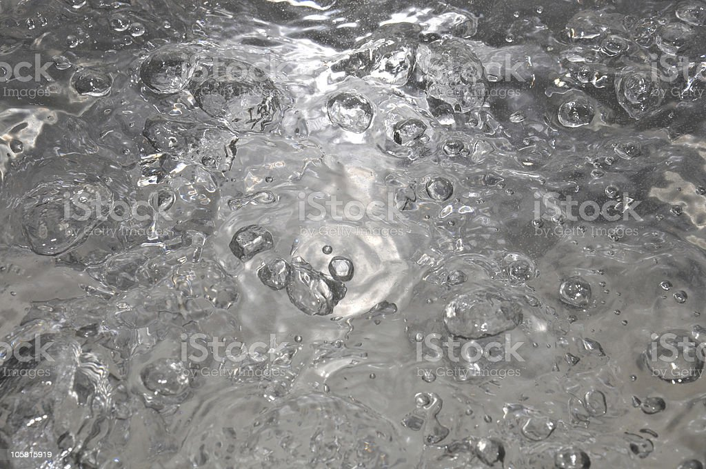 Boiling water covering entire background  stock photo