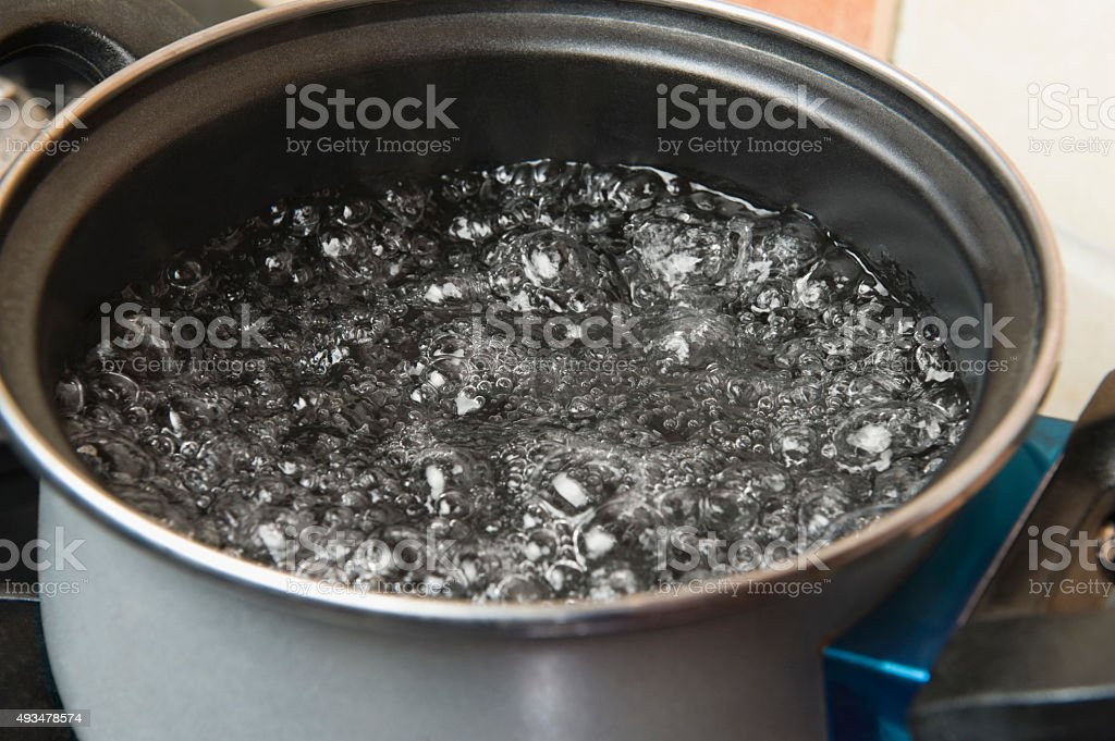 Boiling water in a pot stock photo