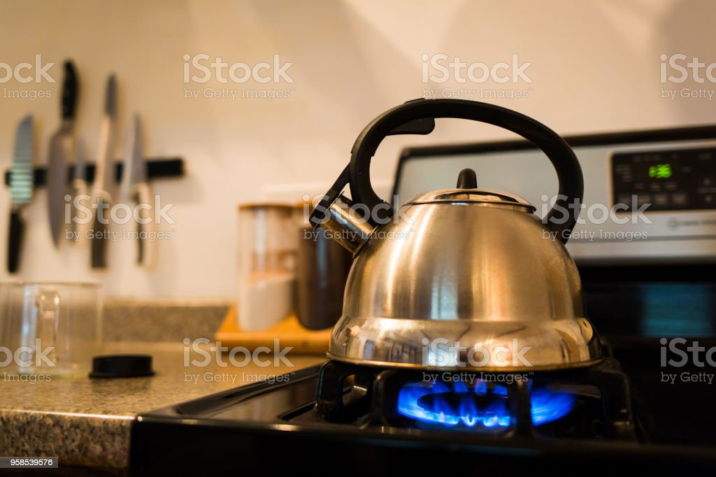 Boiling water in kettle gas stove morning tea stock photo