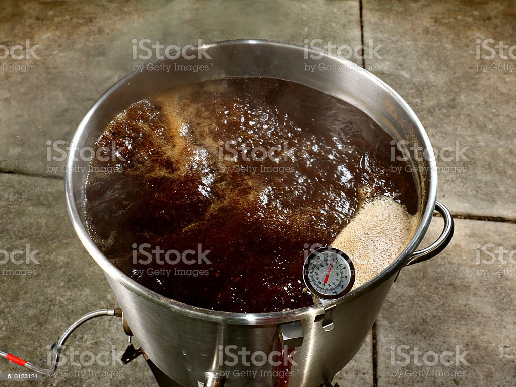 Boiling Wort for Home Brewed Brown Ale stock photo