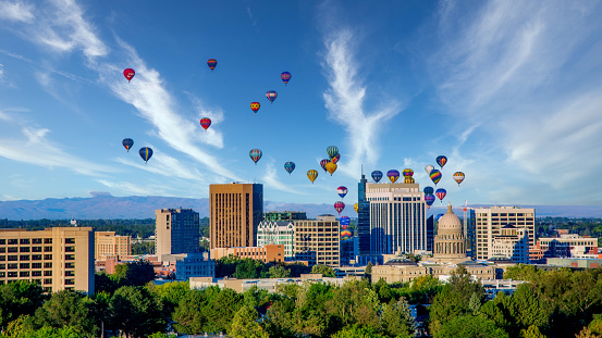 Cloudy sky over Boise with many hot air balloons