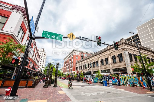 Boise, Idaho, USA - May 26, 2018: Bicycler waiting for the green light in the main street of Boise historic downtown.