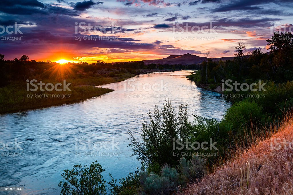 Boise river meandering through a lush landscape at sunset stock photo