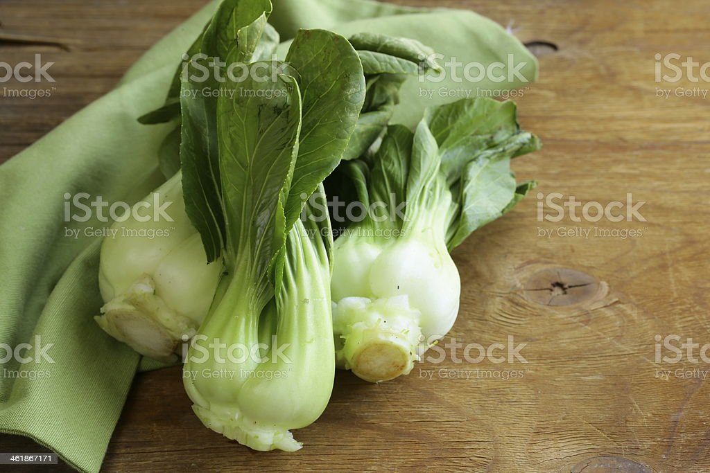 Bok choy (chinese cabbage) on a wooden table royalty-free stock photo