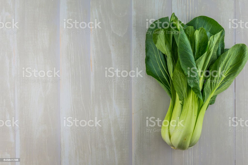 Bok Choy on White Painted Board with Copy Space stock photo