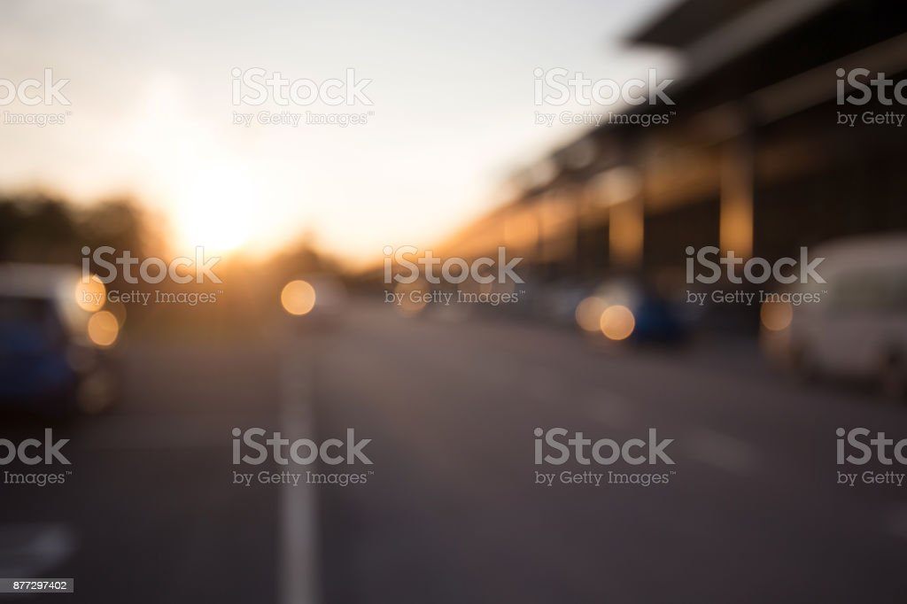 Bokeh background, street, road, sun and car stock photo