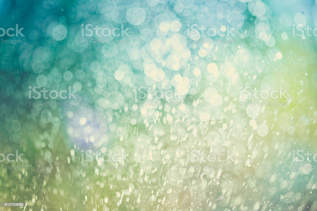 Bokeh Background With Water Spray Splashing And Vibrant Green Color stock photo